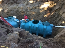 septic tank in ditch
